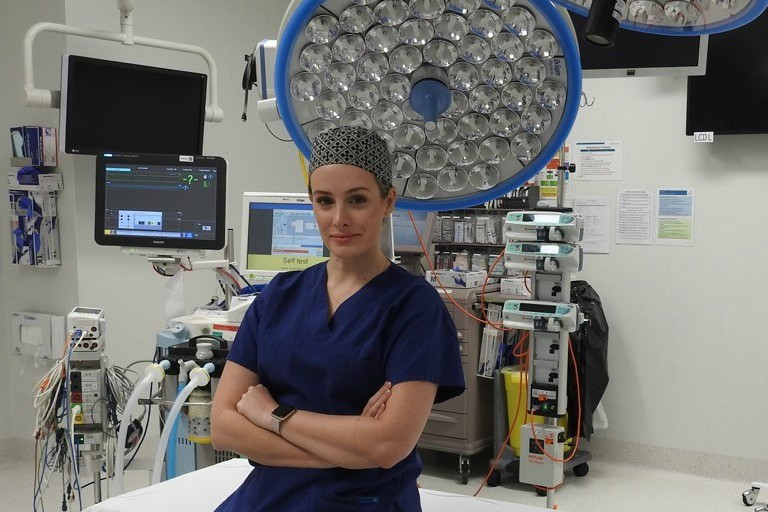 Fiona Stanley Hospital Cardiothoracic Surgeon Dr Nikki Stamp wearing surgical scrubs in an operating theatre