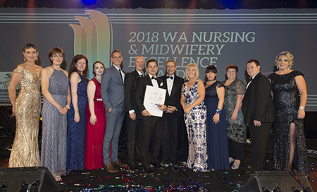 Winners of the WA Nursing and Midwifery Excellence Awards onstage at the 2018 gala dinner