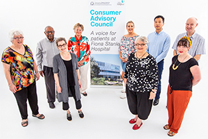 Seven members of the Consumer Advisory Council standing in a semi circular formation